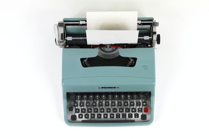 teal and black typewriter machine