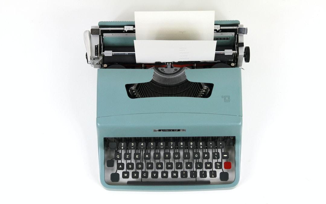 teal and black typewriter machine