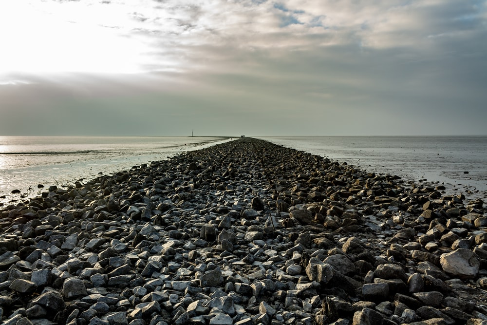 gravel shore pathway during day