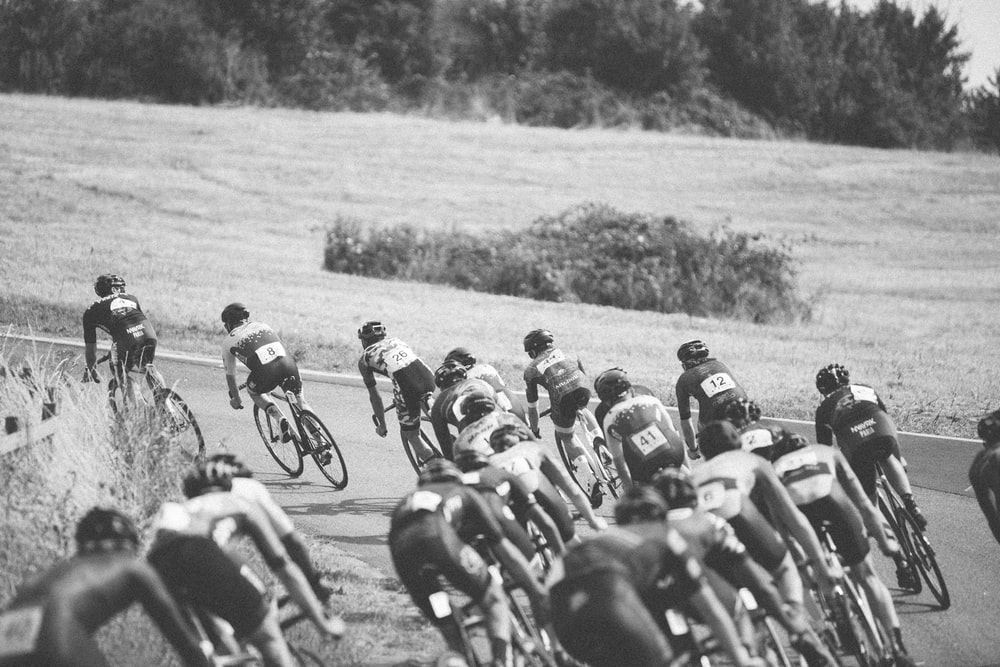 grayscale photo of a bicycle race