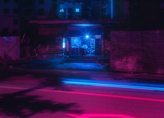 blue light building during nighttime