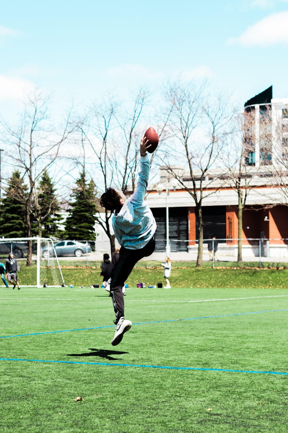 man catching football at the field
