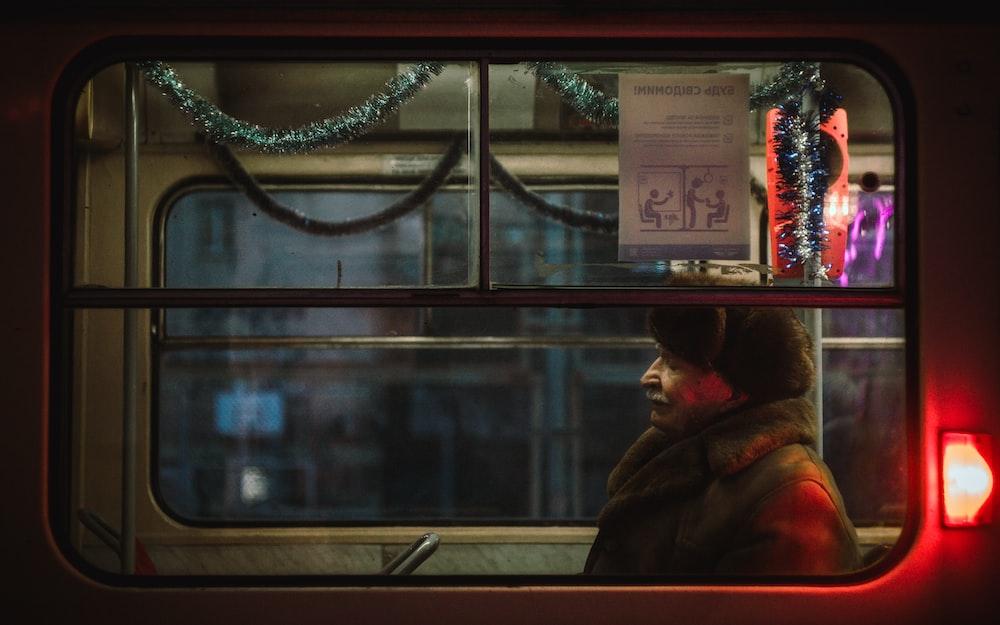 man sitting inside train