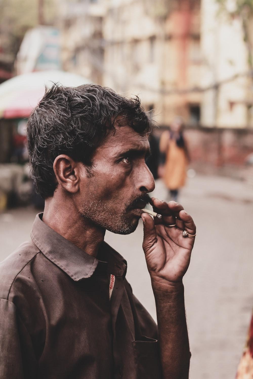 man smokes at the street