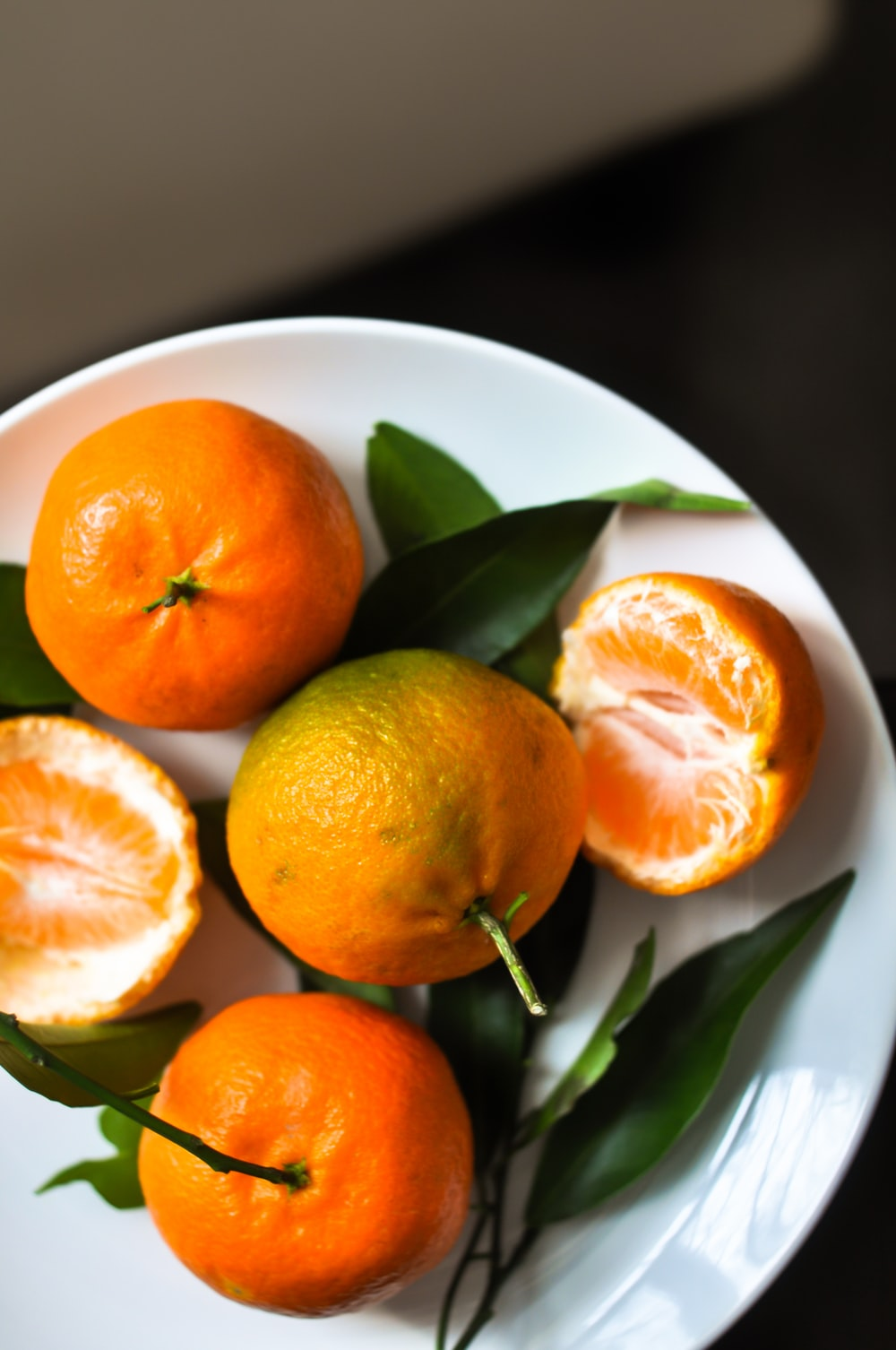 orange fruits on plate