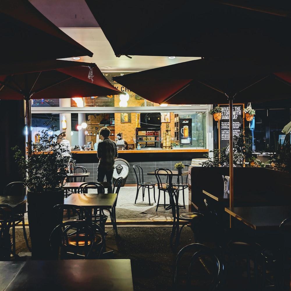 man stands near empty diner