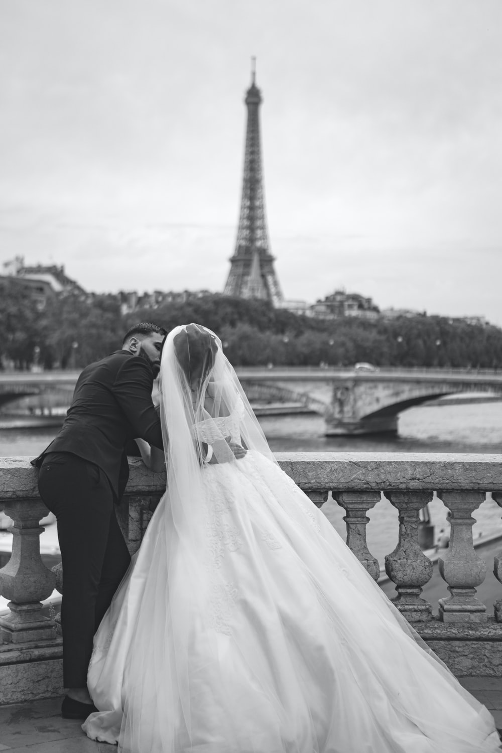 grayscale photography of wedding couple in front of Eiffel Tower