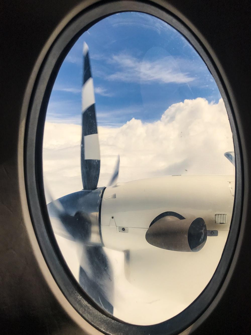 window shot of plane's propeller
