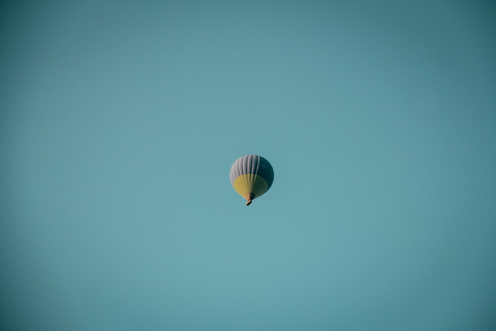 purple and brown hot-air balloon under blue sky