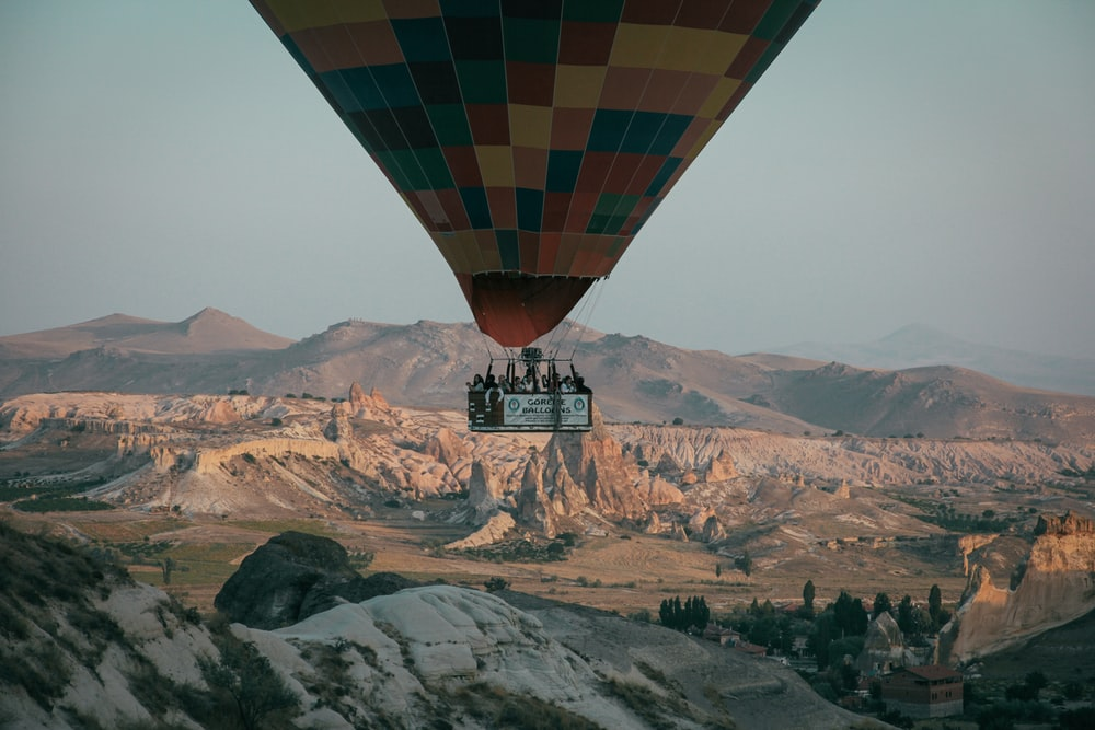 floating hot air balloon during daytime