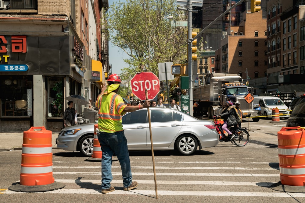 man standing on pedestrian lane