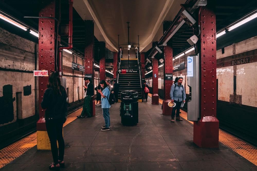 people standing beside train