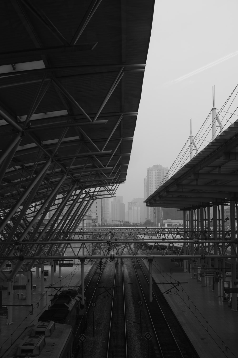 grayscale photography of metal trusses