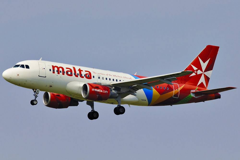 Malta airliner in mid air during day