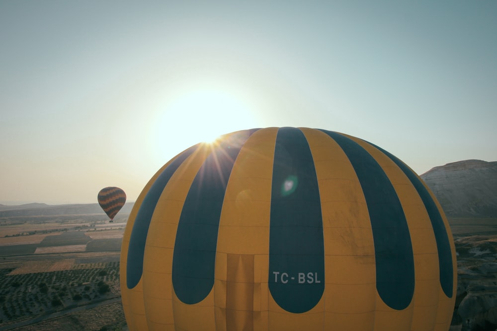 yellow and blue hotair balloon