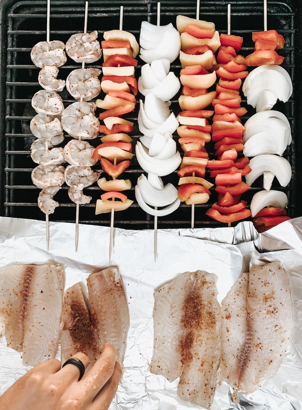 skewered food on grill