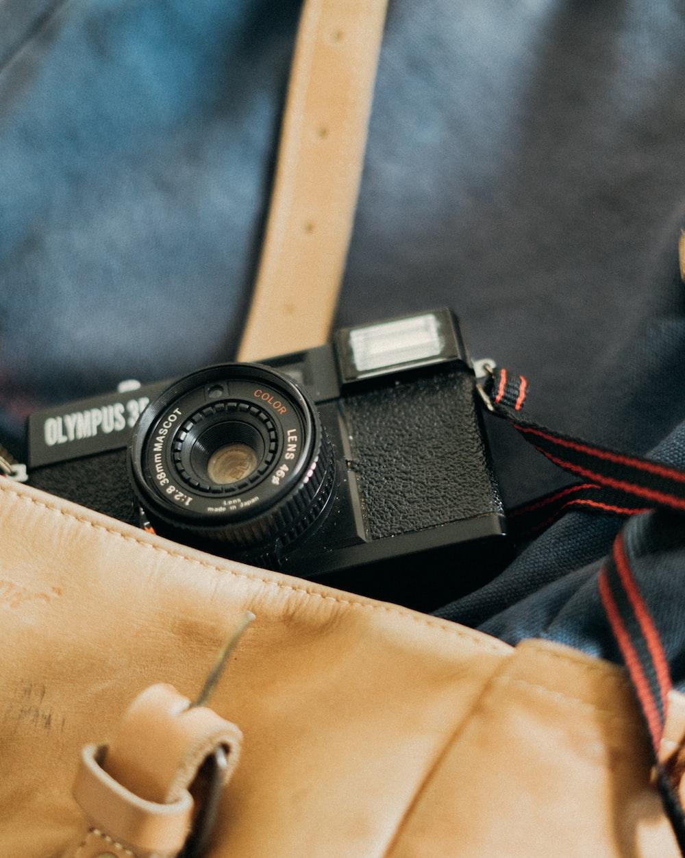 black camera on bag
