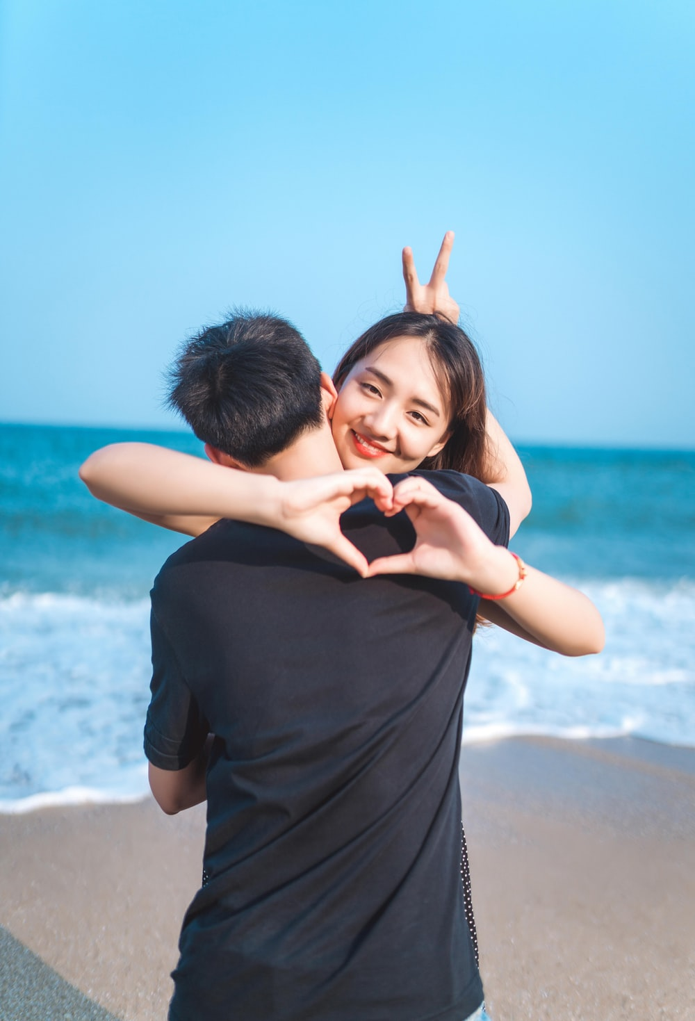 couple hugging standing on shore