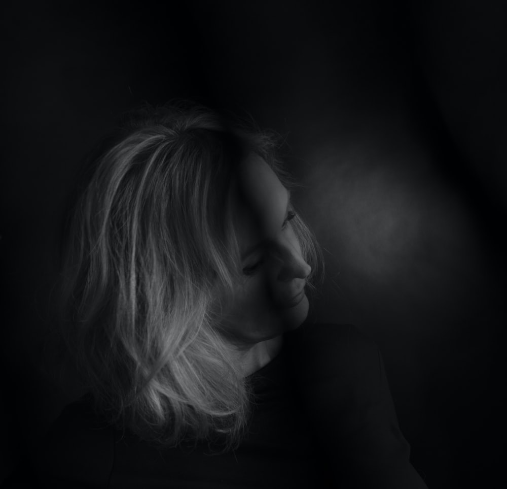 woman in greyscale photography