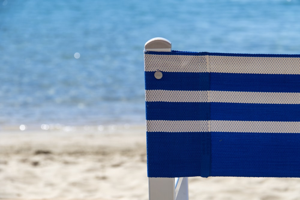 white and blue striped beach chair