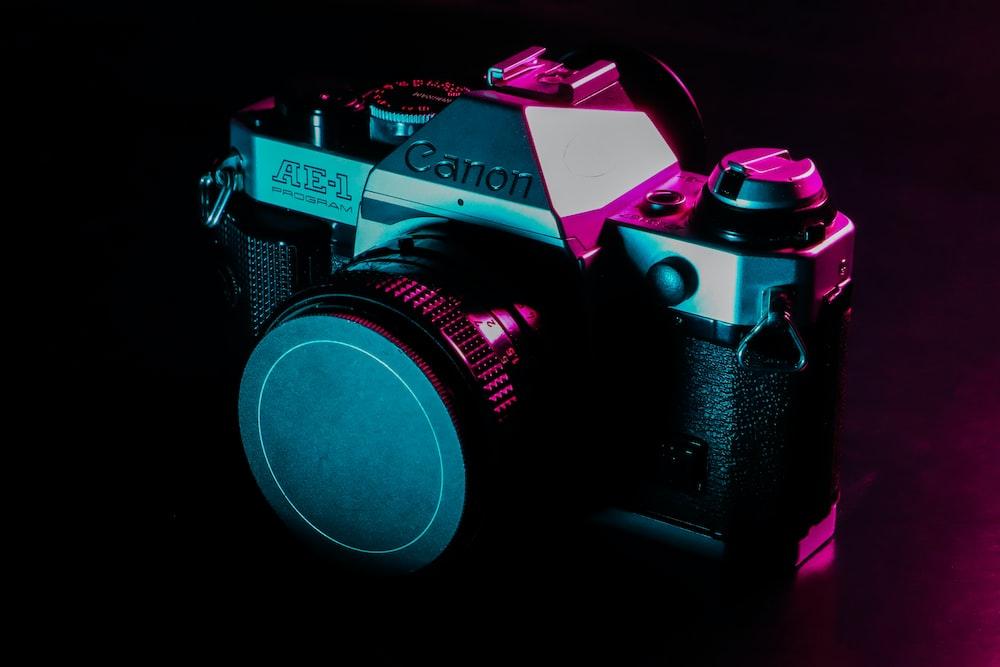 black and silver canon AE-1 camera