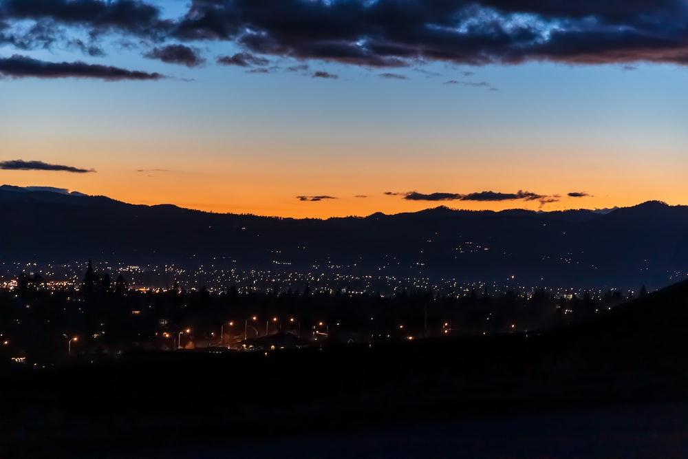 city view at night under orange and blue skies
