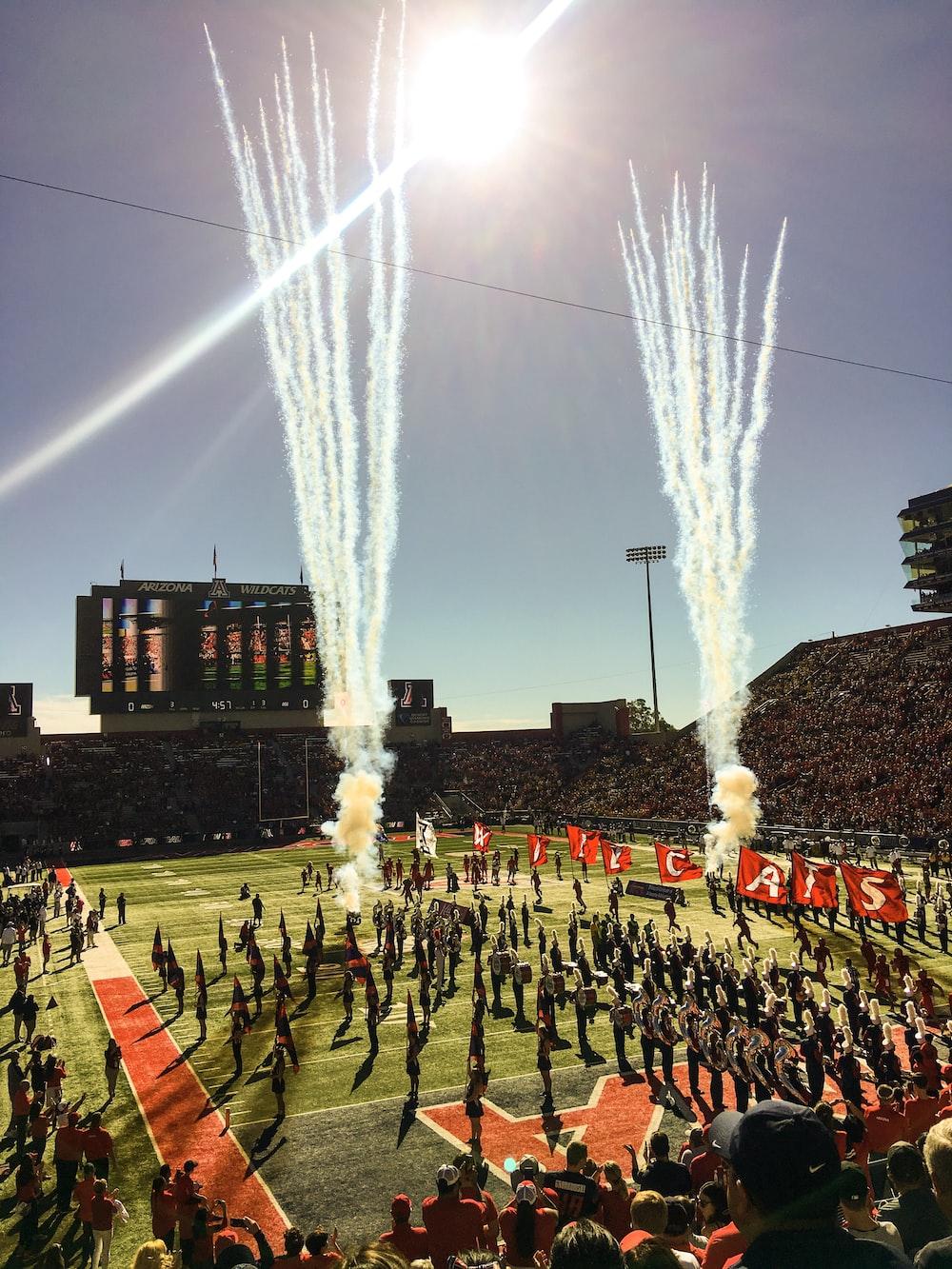 people standing at stadium