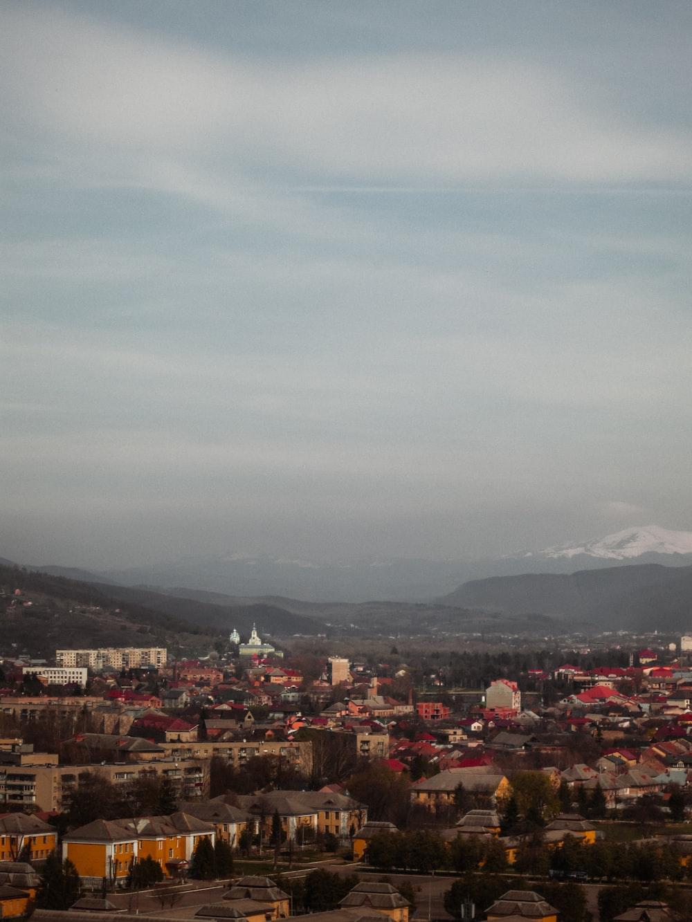 aerial photo of houses under cloudy sky near niybtaubs