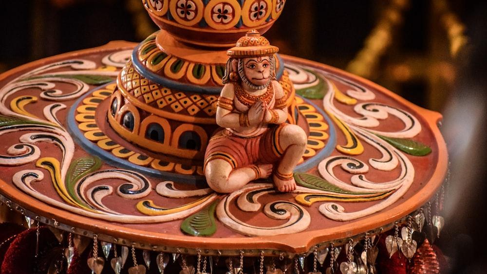 shallow focus photo of ceramic Hanuman figurine