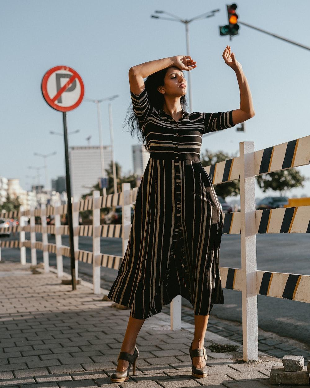 woman wearing black and white striped dress