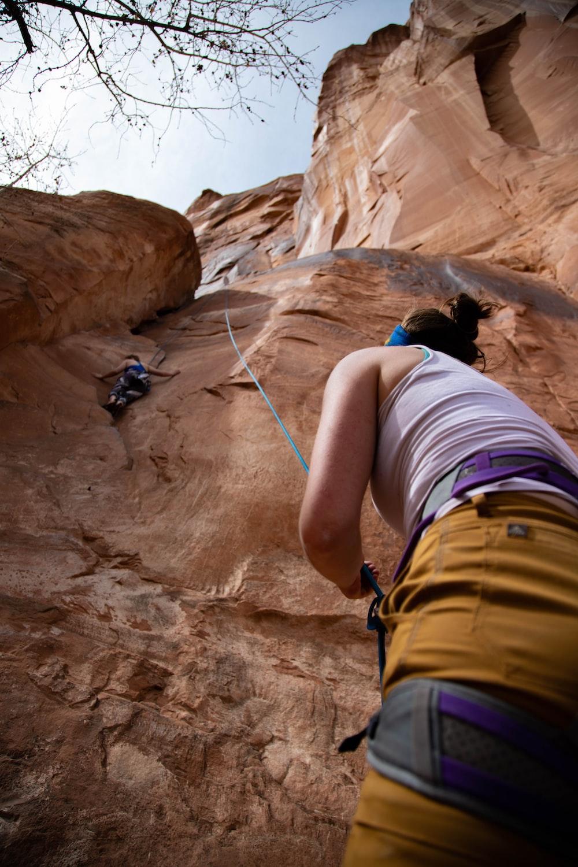 person climbing mountain during daytime