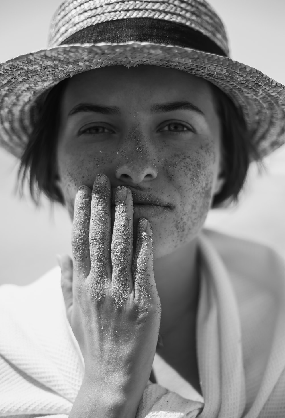 grayscale photography of woman wearing sunhat