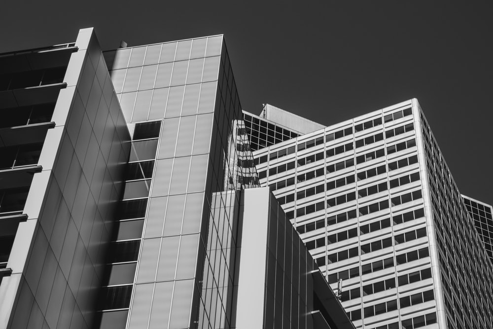 greyscale photo of high-rise building