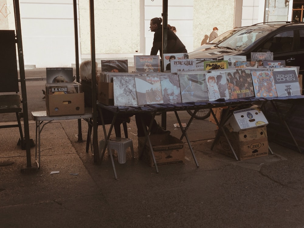 assorted vinyl records lot on display in sidewalk