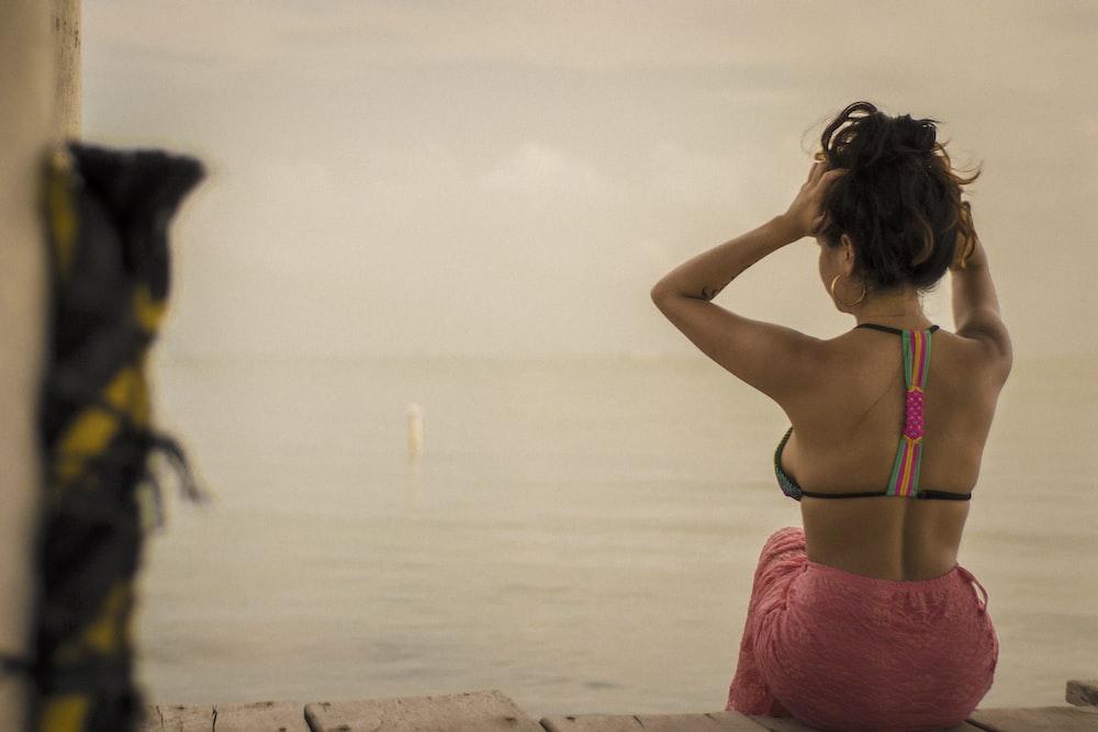 woman wearing black halter bikini top