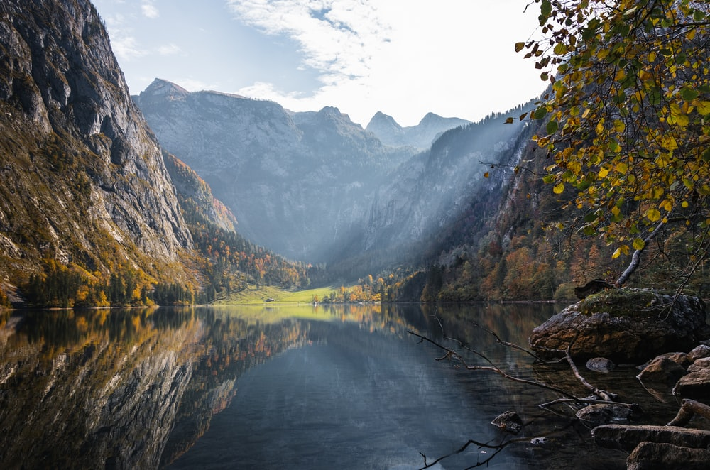 mountain beside body of water during daytime
