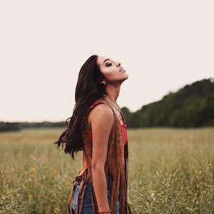 woman standing near grass field