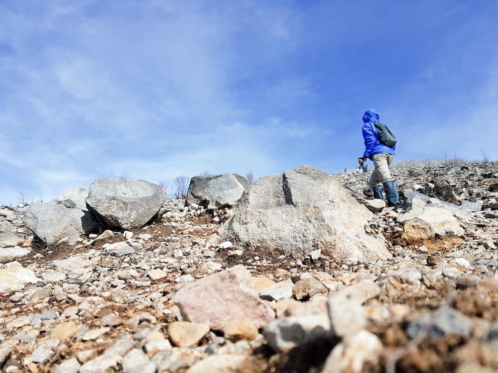 person climbing hill