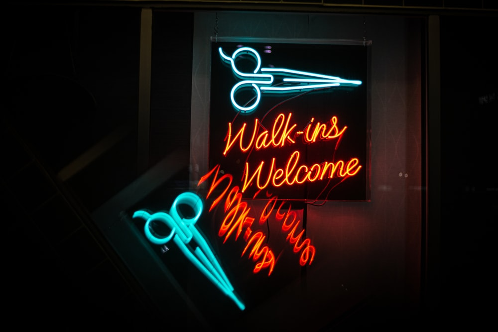 green and orange Walk-ins Welcome neon sign
