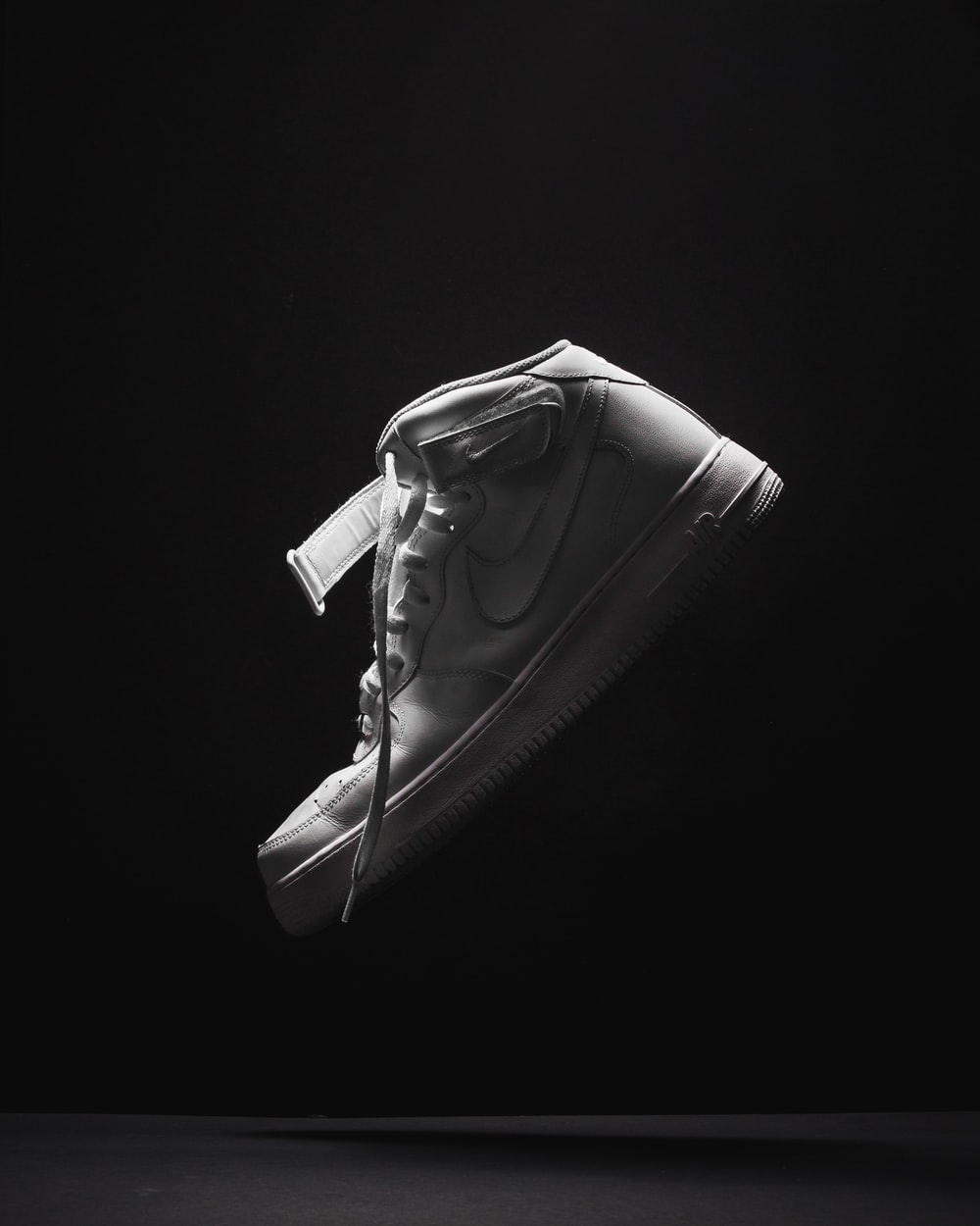 unpaired white Nike Air Force 1