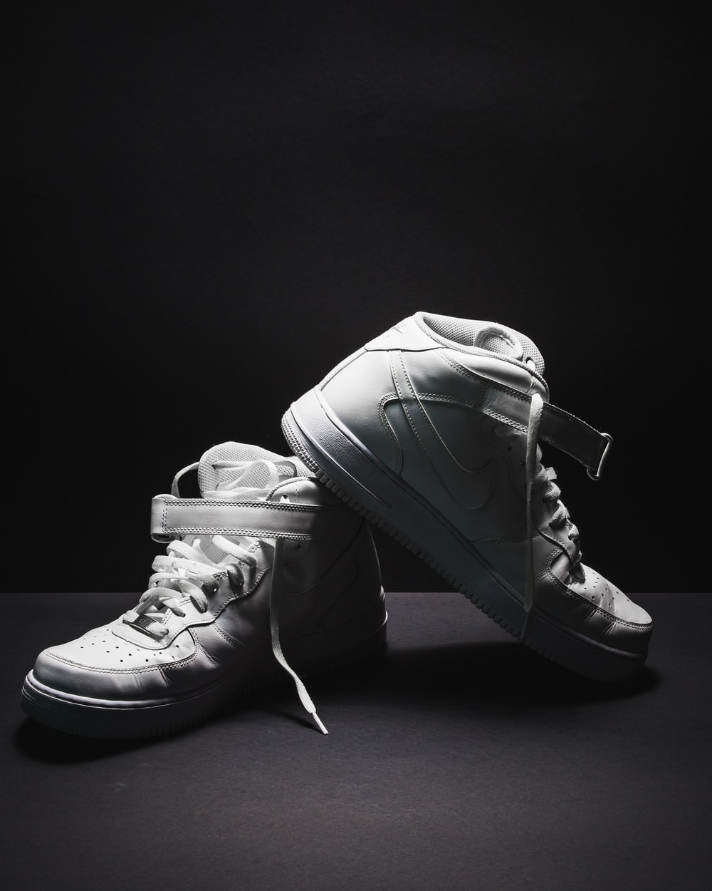 pair of white Nike Air Force 1 sneakers