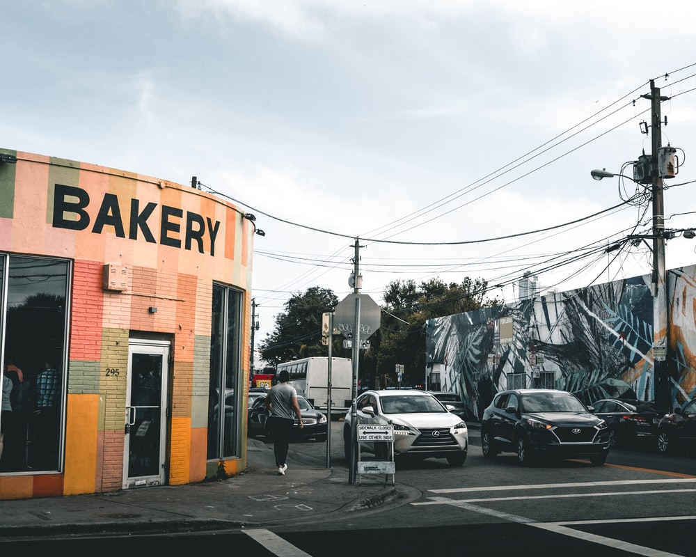 architectural photography of pink and yellow bakery store