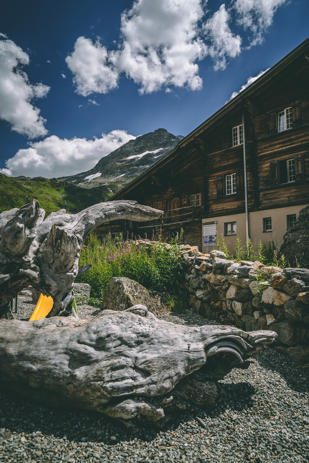 brown house near mountain