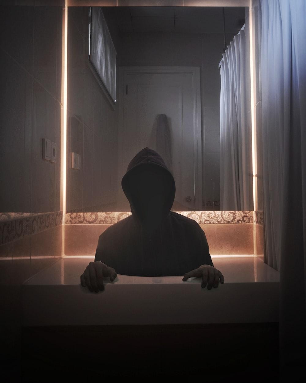 person wearing hoodie inside room