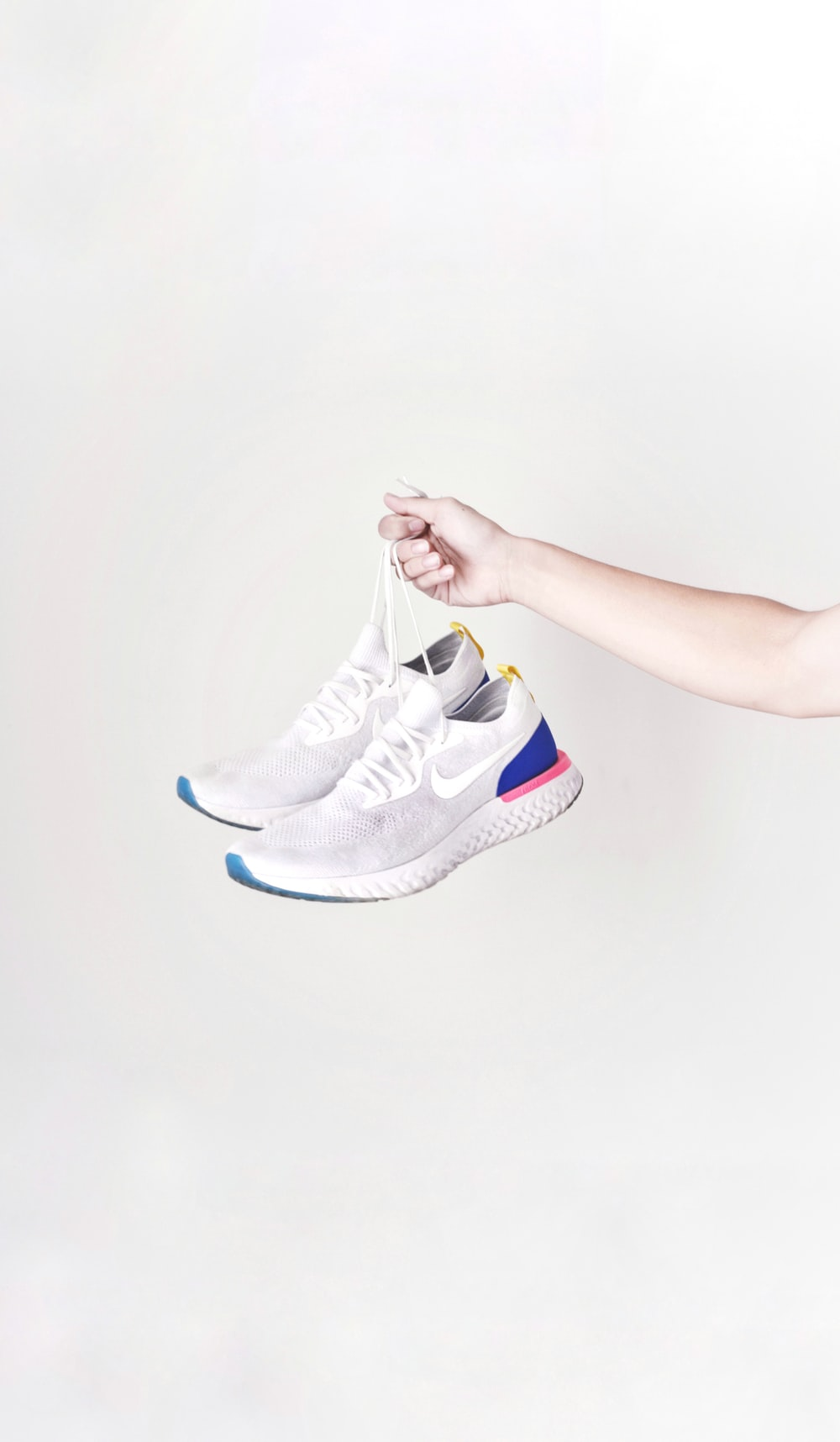 person holding Nike running shoes