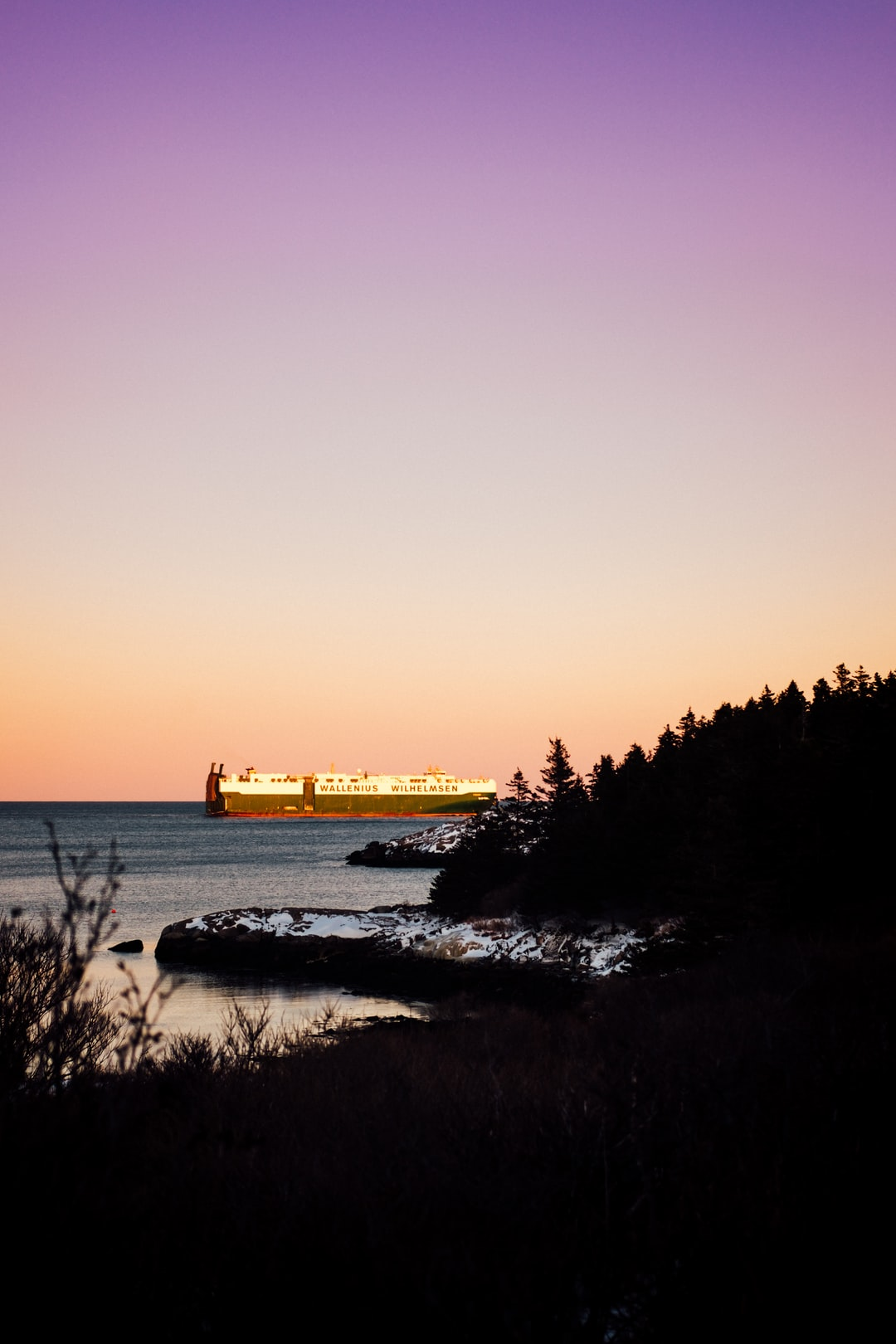 Container ship leaving the Halifax port at sunset