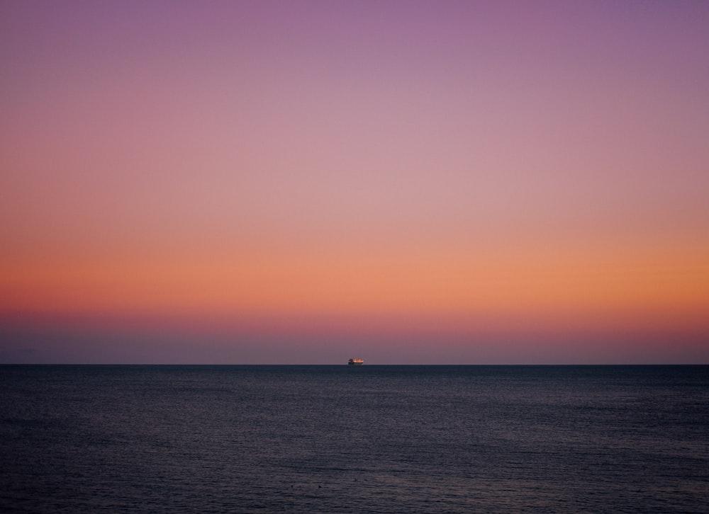 ship sailing at the sea during sunset