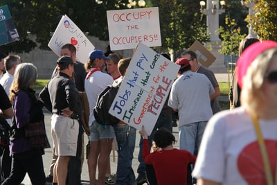 shallow focus photo of people holding signages