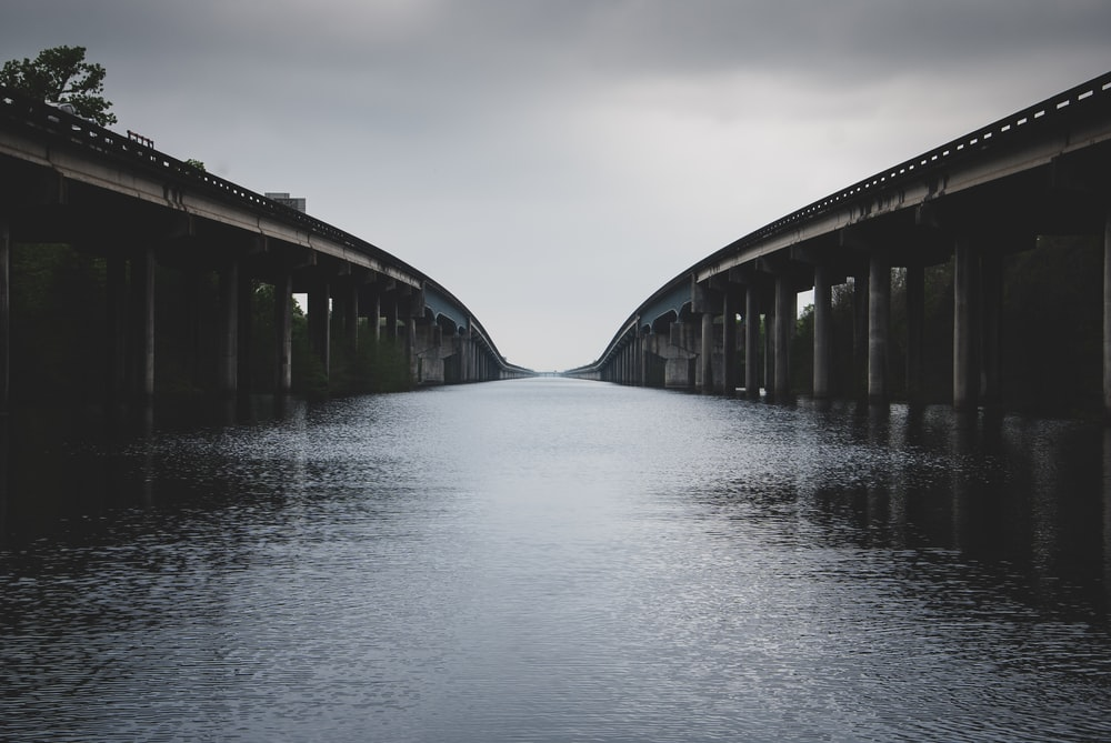calm body of water between bridges