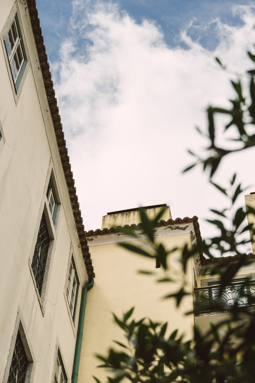 beige building under cloduy sky